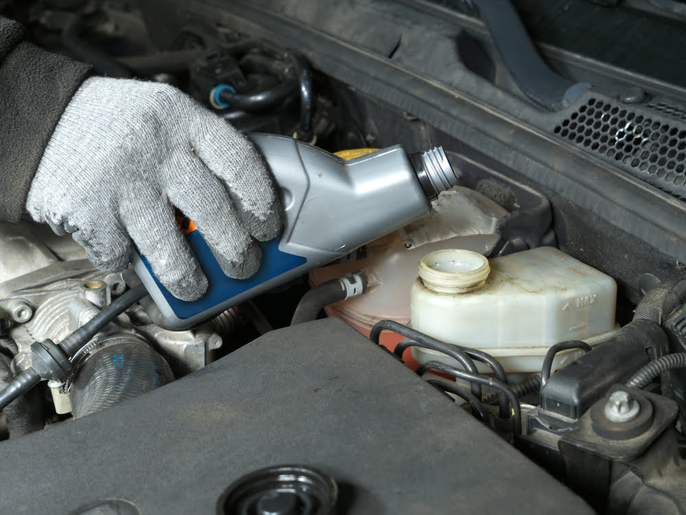 You should pour some more of the new brake fluid in